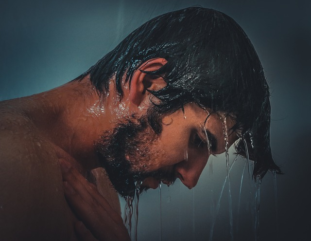 Man in the shower with wet hair