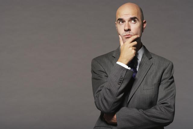 bald business man thinking